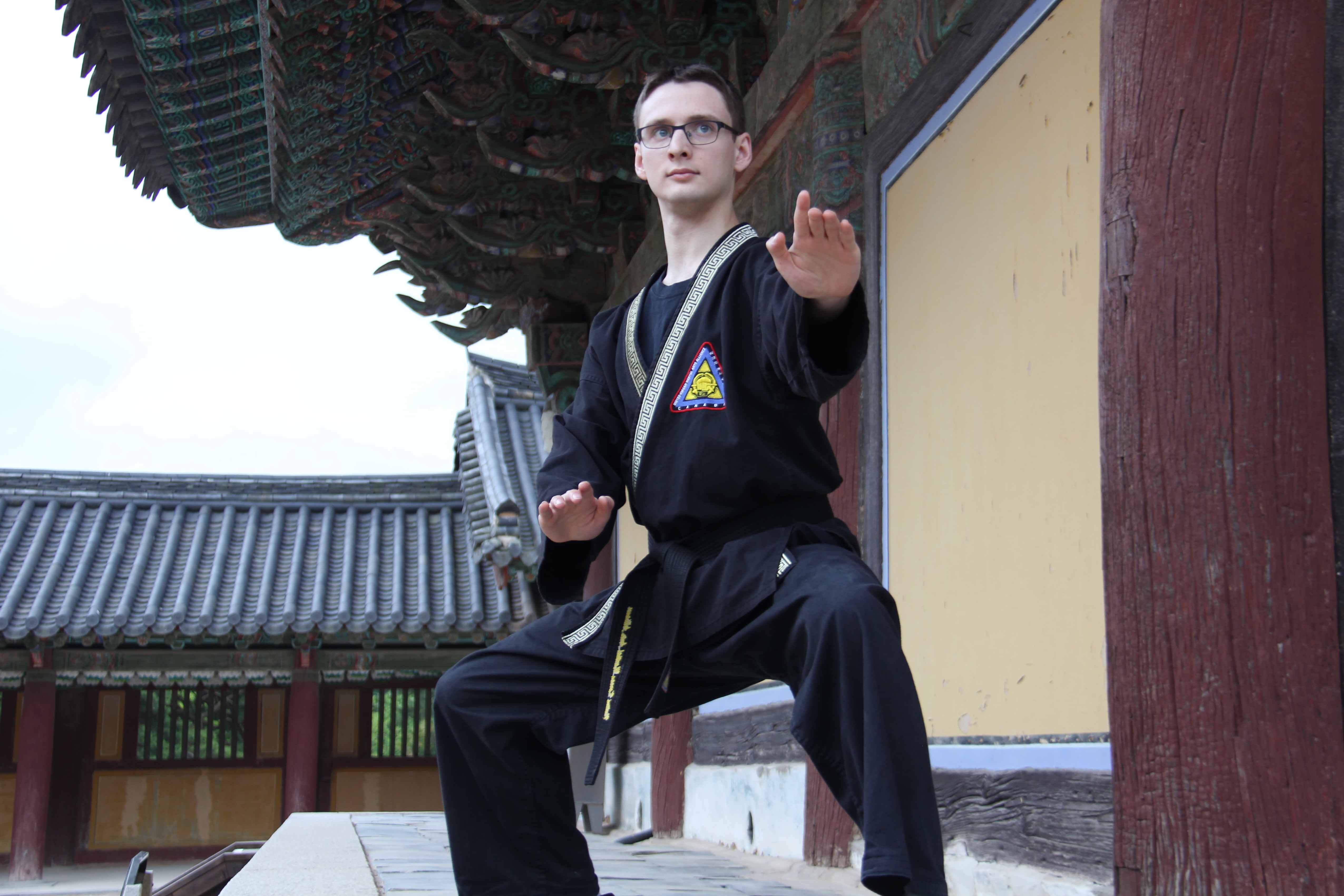 Instructor Martin St-Amant strikes a pose in South Korea.